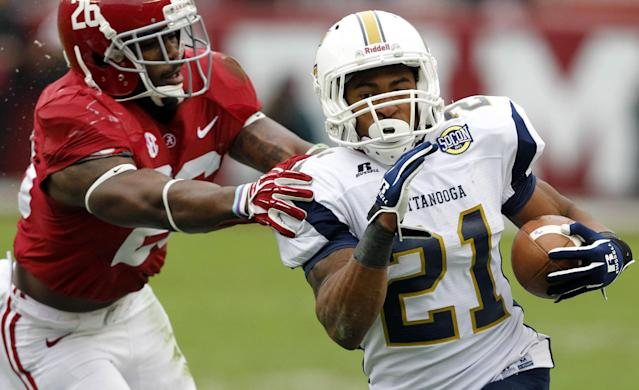 Chattanooga running back Marquis Green (21) gets around Alabama defensive back Landon Collins (26) for a first down run during the first half of an NCAA college football game on Saturday, Nov. 23, 2012, in Tuscaloosa, Ala. (AP Photo/Butch Dill)