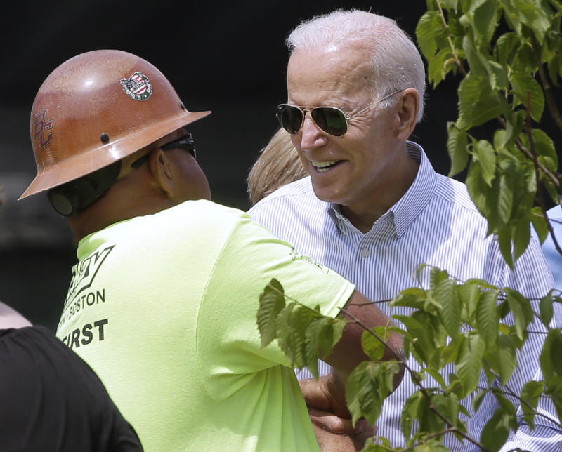 Joe Biden chats with a construction worker during a visit to Boston on June 5.