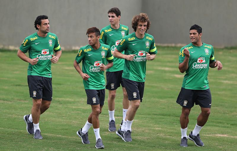 FILE - In this June 28, 2013 file photo, Brazil's players, from left to right: Fred, Neymar, Oscar, David Luiz, and Hulk attend a training session in Rio de Janeiro, Brazil. Brazilian fans hoping for a home-team win at this year's World Cup are hoping just ashard that archrival Argentina does not lift the trophy. (AP Photo/Andre Penner, File)