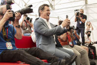 FILE - In this Sept, 3, 2021 file photo Josh Brolin, centre, takes photograph with his cell phone at the photo call for the film 'Dune' during the 78th edition of the Venice Film Festival in Venice, Italy. (Photo by Joel C Ryan/Invision/AP, File)