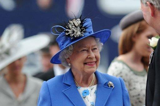 The queen was  driven across the racecourse in an open-topped vehicle