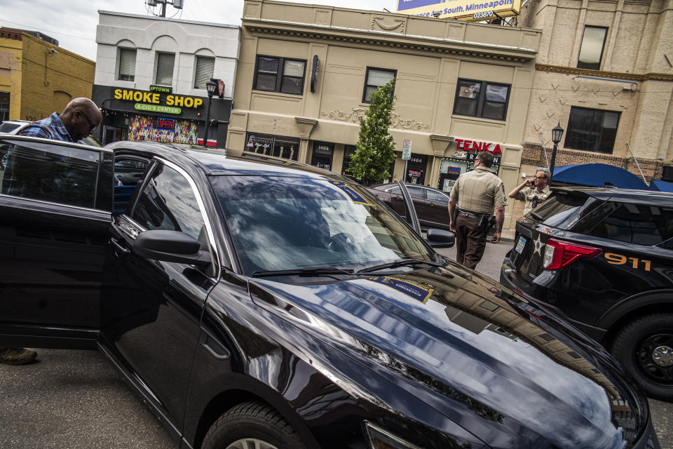 Police officers investigate a fatality in an officer involved shooting, Thursday, June 3, 2021 in Minneapolis. One person was killed Thursday when authorities who were part of a task force that included U.S. Marshals fired their weapons after the person displayed a handgun in Minneapolis' Uptown neighborhood, the U.S. Marshals said. (Richard Tsong-Taatarii/Star Tribune via AP)