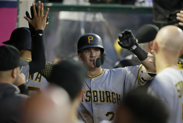 Pittsburgh Pirates' Kevin Newman gets congratulations from teammates after hitting a solo home run during the second inning of a baseball game against the Los Angeles Angels in Anaheim, Calif., Monday, Aug. 12, 2019. (AP Photo/Alex Gallardo)