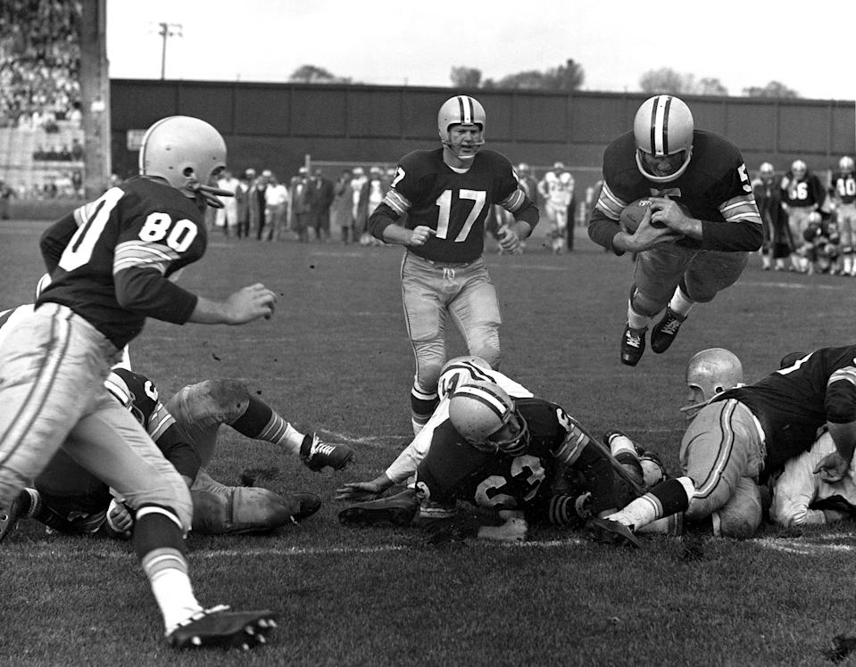 Green Bay Packers halfback Paul Hornung (5) plunged over the line for a touchdown against the San Francisco 49ers in 1960. (AP Photo)
