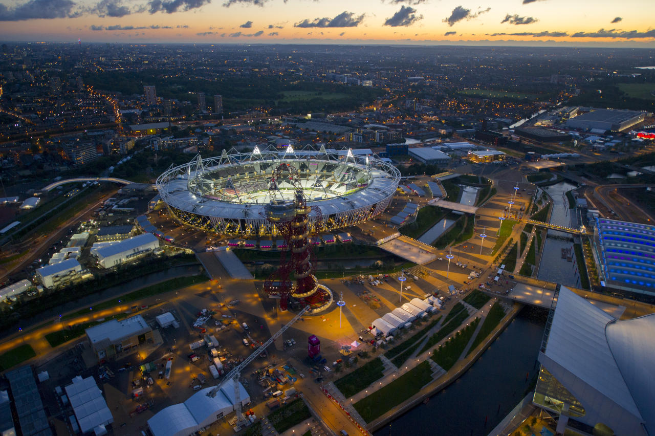 LONDON;UNITED KINGDOM - JUNE 28: A general aerial view of the Olympic Stadium at dusk at the 2012 Olympic Park on June 28,2012 in Stratford,London,England. (Photo by Jason Hawkes/Getty Images)