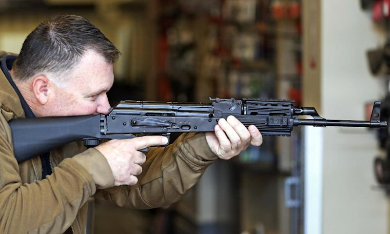 Clark Aposhian, chairman of the Utah Shooting Sports Council, demonstrates how a bump stock works when attached to a semi-automatic rifle on Wednesday in South Jordan, Utah.
