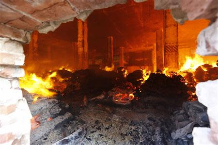 A fire burns inside the warehouse of a Standard Group garment factory in Gazipur November 29, 2013. There were no reports of casualties in the fire. REUTERS/Andrew Biraj