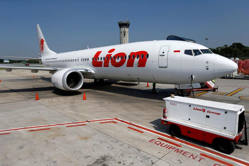 FILE PHOTO: Lion Air's Boeing 737 Max 8 airplane is parked on the tarmac of Soekarno Hatta International airport near Jakarta, Indonesia, March 15, 2019. REUTERS/Willy Kurniawan/File Photo