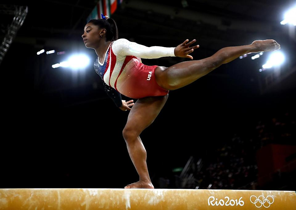 <p>Simone Biles of the United States competes on the balance beam during the Artistic Gymnastics Women's Team Final on Day 4 of the Rio 2016 Olympic Games at the Rio Olympic Arena on August 9, 2016 in Rio de Janeiro, Brazil. (Photo by Laurence Griffiths/Getty Images) </p>