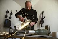 Macura transforms decommissioned weapons into musical instruments