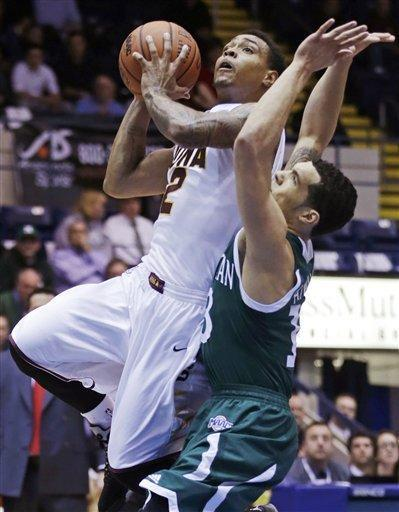 Iona guard Lamont Jones, left, drives to the basket past Manhattan forward Emmy Andujar, right, during the first half of the 2013 MAAC Championship NCAA college basketball game in Springfield, Mass., Monday, March 11, 2013. (AP Photo/Charles Krupa)