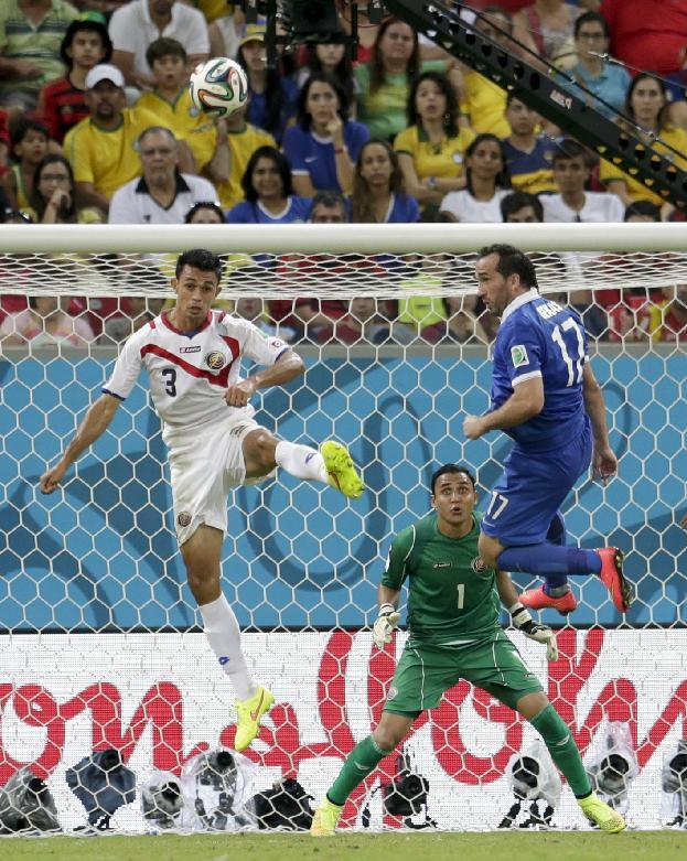 Costa Rica's goalkeeper Keylor Navas watches as Giancarlo Gonzalez (3) clears the ball in front of Greece's Fanis Gekas during the World Cup round of 16 soccer match between Costa Rica and Greece at the Arena Pernambuco in Recife, Brazil, Sunday, June 29, 2014. (AP Photo/Petr David Josek)