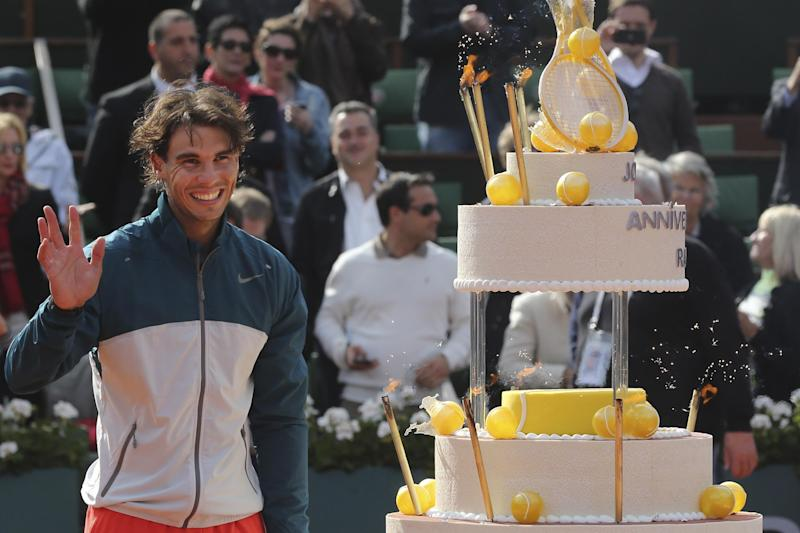 Spain's Rafael Nadal celebrates his 27th birthday on center court after defeating Japan's Kei Nishikori in three sets 6-4, 6-1, 6-3, in their fourth round match at the French Open tennis tournament, at Roland Garros stadium in Paris, Monday June 3, 2013. (AP Photo/Michel Euler)