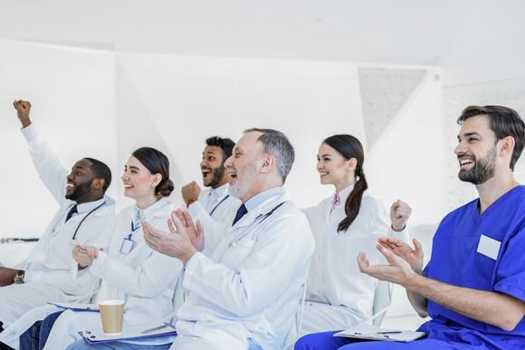 A crowd of cheering healthcare professionals.