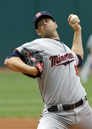 Minnesota Twins starting pitcher Scott Diamond delivers against the Cleveland Indians in the first inning of a baseball game on Sunday, June 3, 2012, in Cleveland. (AP Photo/Mark Duncan)