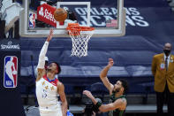 New Orleans Pelicans guard Josh Hart (3) goes to the basket against Boston Celtics forward Jayson Tatum (0) in the second half of an NBA basketball game in New Orleans, Sunday, Feb. 21, 2021. (AP Photo/Gerald Herbert)