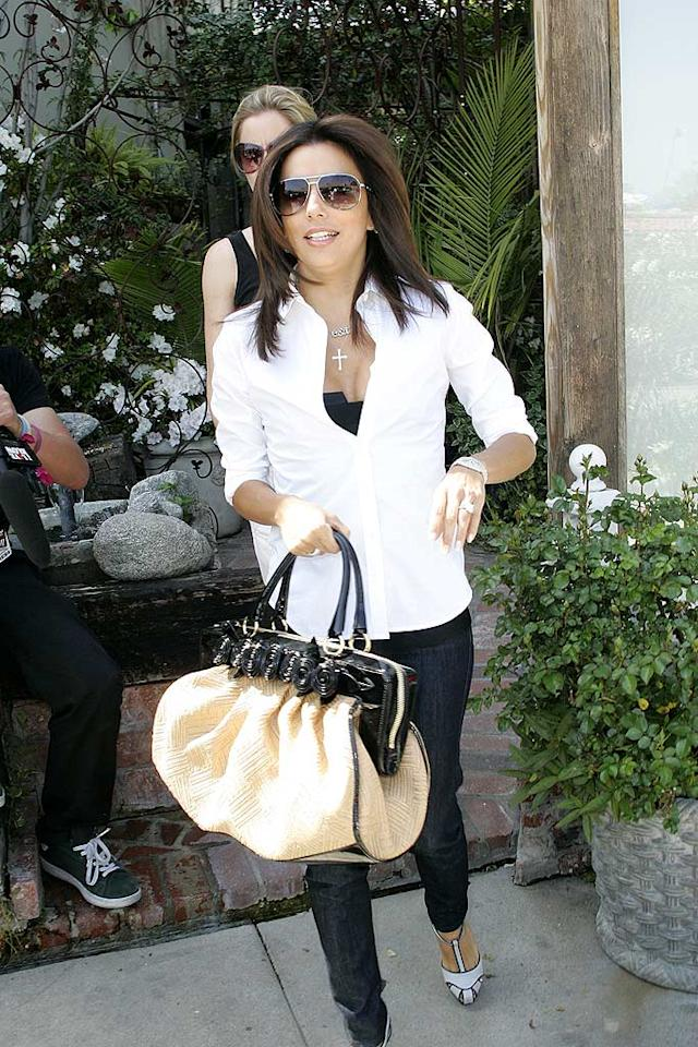 "With a fab bag in hand, plenty o' bling, and a sexy $75 blowout from her stylist/BFF Ken Paves, Eva Longoria looks far from ""desperate."" HookedOnHollywood/<a href=""http://www.splashnewsonline.com"" target=""new"">Splash News</a> - March 21, 2008"