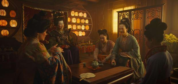 L—R: Groom's mother, the Matchmaker (Pei-Pei Cheng), little sister Xiu (Xana Tang), Wuwei (Rosalind Chao) and Mulan.