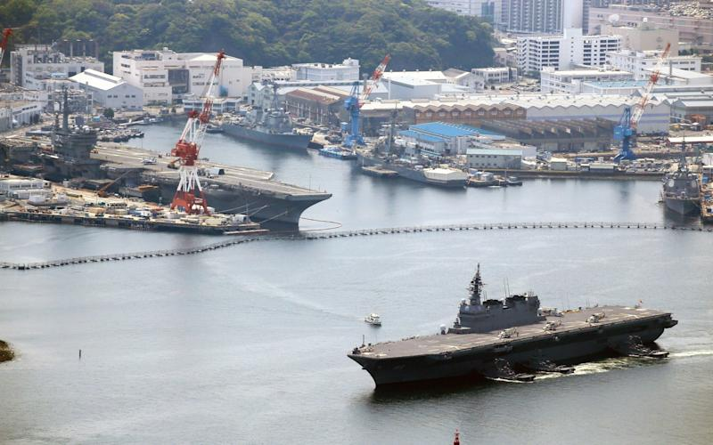 The Izumo leaves its base - Credit: The Asahi Shimbun /Getty Images