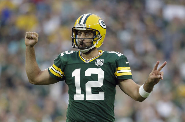 The Green Bay Packers just gave Aaron Rodgers a massive contract, but that doesn't mean you need to overpay for him or any quarterback in your fantasy draft. (AP Photo/Jeffrey Phelps, File)