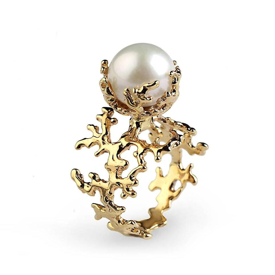 <p>This <span>Gold Pearl Engagement Ring</span> ($1,267, originally $1,490) living sculptures of coral and features a round white pearl.</p>