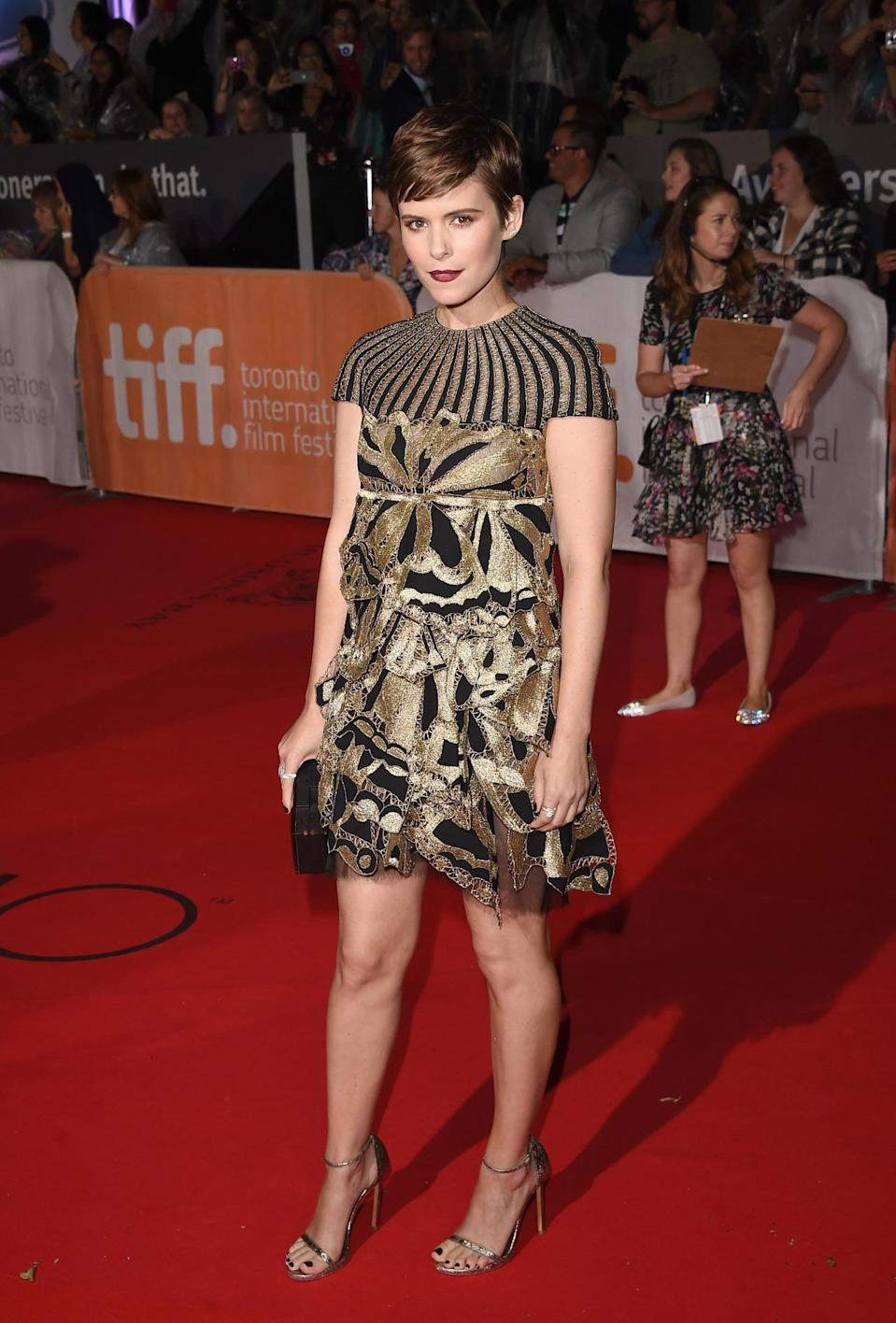 """<p>The red carpet doesn't always require floor-sweeping gowns. Case in point: Kate Mara at """"The Martian"""" premiere at the Toronto International Film Festival. Wearing a gold and black Valentino mini dress, she still looked elegant even without the length, </p>"""