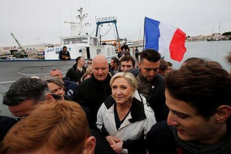 Marine Le Pen, French National Front (FN) political party candidate for French 2017 presidential election, leaves a fishing boat after a campaign visit to the port in Grau-du-Roi