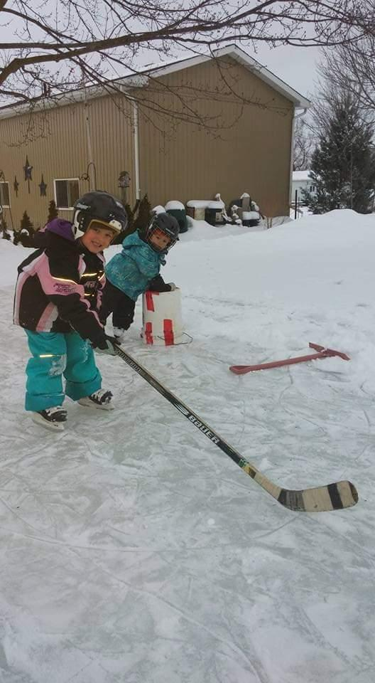 """Dunham's """"Blue Ice"""" Team. Each year Dunham would build a skating rink for his daughters, Reydian and Atlin. Image via Krista Lambier."""