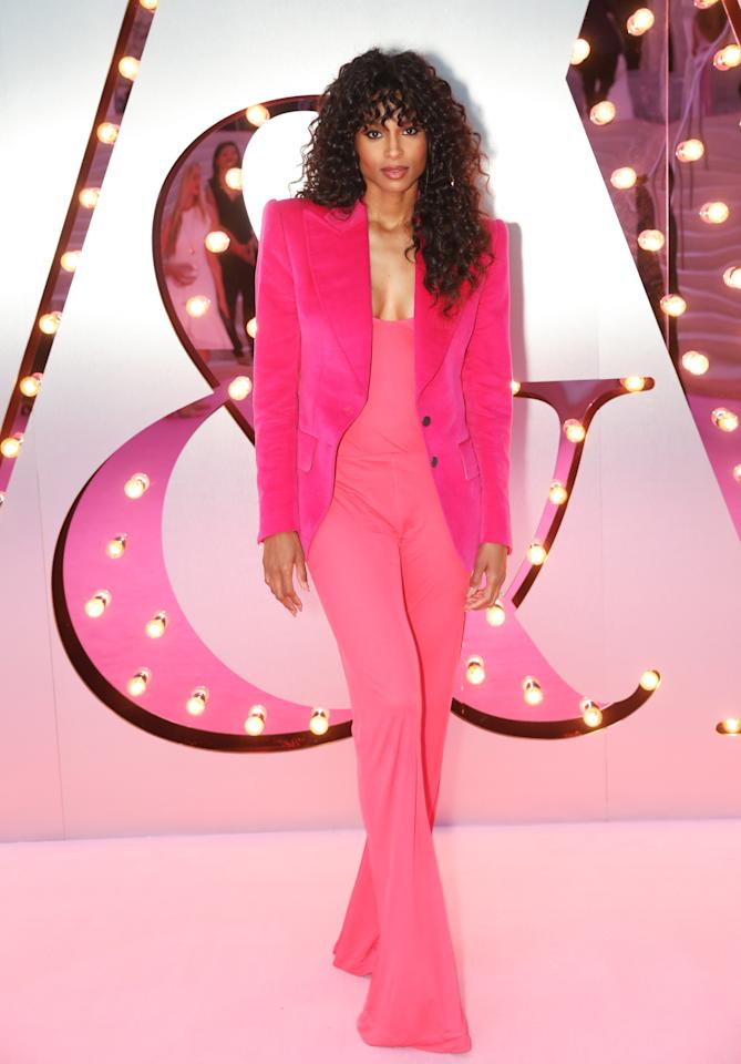 <p>What a woman! Ciara looked like an 80s superstar wearing a hot pink jumpsuit with bold-shouldered blazer and big curls. <br />[Photo: Getty] </p>