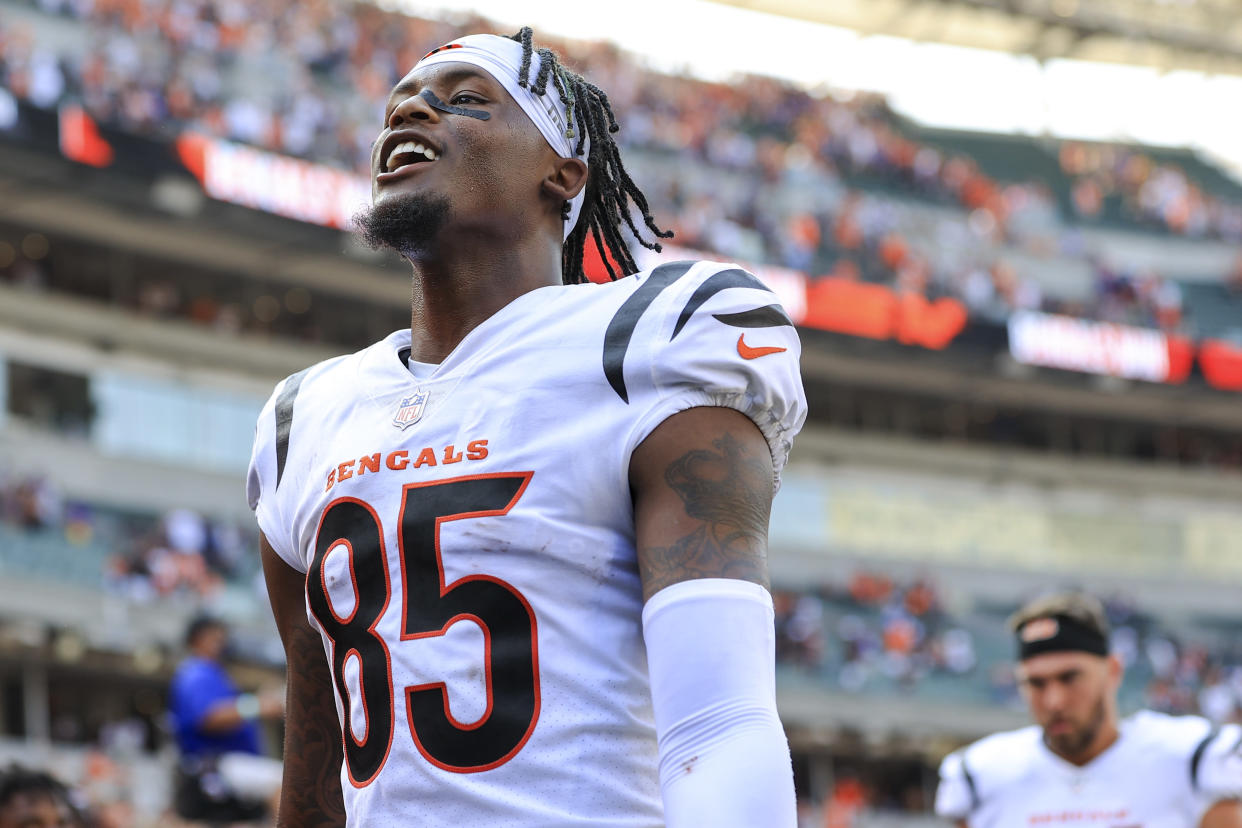 Cincinnati Bengals wide receiver Tee Higgins (85) reacts as he walks off the field after an NFL football game against the Minnesota Vikings, Sunday, Sept. 12, 2021, in Cincinnati. The Bengals won 27-24. (AP Photo/Aaron Doster)