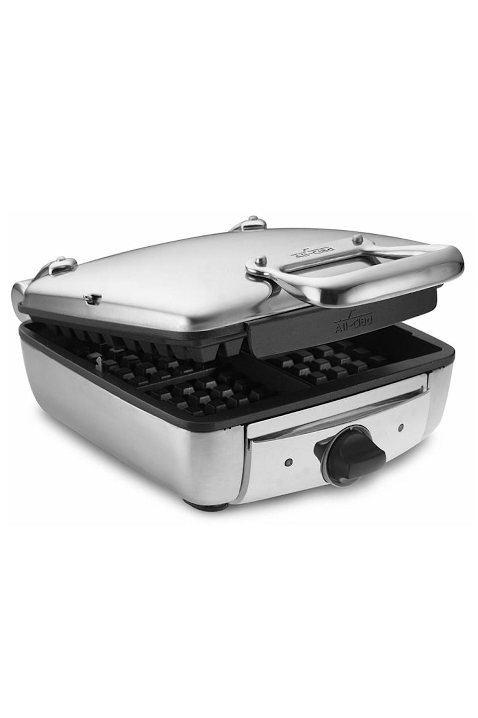 """<p><strong>All-Clad</strong></p><p>Williams-Sonoma</p><p><strong>$179.95</strong></p><p><a href=""""https://go.redirectingat.com?id=74968X1596630&url=https%3A%2F%2Fwww.williams-sonoma.com%2Fproducts%2Fall-clad-electric-belgian-waffle-maker&sref=https%3A%2F%2Fwww.cosmopolitan.com%2Flifestyle%2Fg34965234%2Fbest-waffle-makers%2F"""" rel=""""nofollow noopener"""" target=""""_blank"""" data-ylk=""""slk:shop now"""" class=""""link rapid-noclick-resp"""">shop now </a></p><p>Crispy on the outside, yet tender on the inside—this is how the perfect waffle should be, and you'll definitely get that with this maker. Plus, if you're messy with the batter, this has a moat to catch it all (bless up).</p>"""