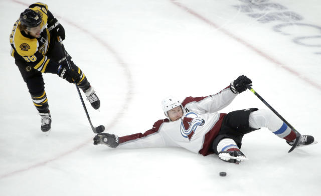 Boston Bruins's David Pastrnak (88), of Czech Republic, and Colorado Avalanche's Erik Johnson (6) vie for control of the puck during the first period of an NHL hockey game, Sunday, Feb. 10, 2019, in Boston. (AP Photo/Steven Senne)