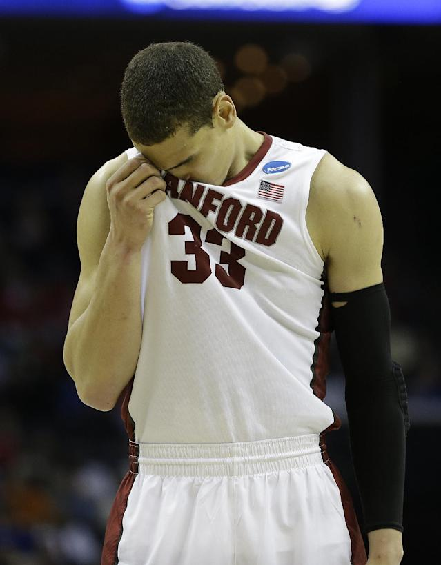 Stanford forward Dwight Powell (33) reacts after a Stanford foul against Dayton during the second half in a regional semifinal game at the NCAA college basketball tournament, Thursday, March 27, 2014, in Memphis, Tenn. (AP Photo/Mark Humphrey)