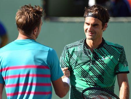 Mar 19, 2017; Indian Wells, CA, USA; Roger Federer (SUI) shakes hands with Stan Wawrinka (SUI) after he won the men's singles final 7-6, 6-4 in the BNP Paribas Open at the Indian Wells Tennis Garden. Mandatory Credit: Jayne Kamin-Oncea-USA TODAY Sports