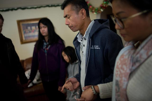 Harry Pangemanan and his family were able to return home on Sunday, Feb. 4. Clergy came with them to bless the house and welcome them home. (Photo: Alan Chin for Yahoo News)