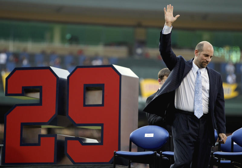 Former Atlanta Braves pitcher John Smoltz waves to the crowd after his jersey was retired during a ceremony before a baseball game between the Braves and the Toronto Blue Jays Friday, June 8, 2012, in Atlanta. Smoltz took his place in Braves history on Friday night when the team retired his No. 29. He was inducted into the Braves Hall of Fame earlier in the day. (AP Photo/David Goldman)