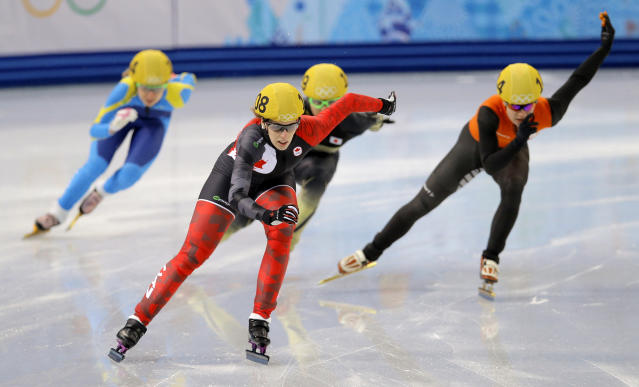 Marianne St-gelais of Canada leads the field in a women's 500m short track speedskating heat at the Iceberg Skating Palace during the 2014 Winter Olympics, Monday, Feb. 10, 2014, in Sochi, Russia. (AP Photo/Vadim Ghirda)