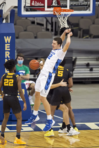 Creighton's Ryan Kalkbrenner celebrates a dunk against Kennesaw State during the first half of an NCAA college basketball game in Omaha, Neb., Friday, Dec. 4, 2020. (AP Photo/Kayla Wolf)