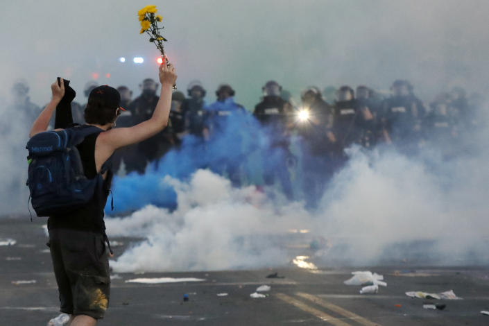 Police move toward a protester after curfew on May 30, 2020, in Minneapolis. (John Minchillo/AP)