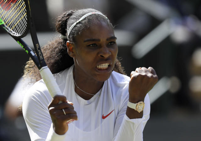 Serena Williams of the United States celebrates winning a game during her women's singles quarterfinals match against Italy's Camila Giorgi, at the Wimbledon Tennis Championships, in London, Tuesday July 10, 2018. (AP Photo/Kirsty Wigglesworth)