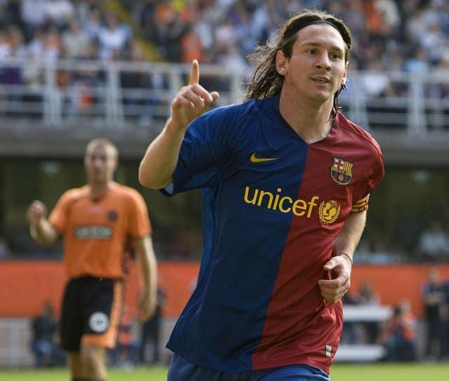 Lionel Messi celebrates after scoring for Barcelona in a pre-season friendly at Dundee United