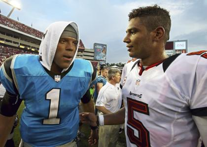 QB Cam Newton shares a word with counterpart Josh Freeman after Carolina fell to Tampa Bay. (Reuters)
