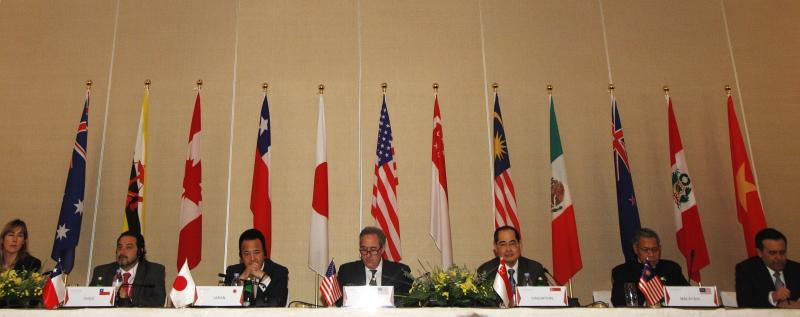 U.S. Trade Representative Froman, Singapore's trade minister Lim meet with pacific rim trade ministers including Japan's Economics Minister Amari during a news conference to conclude the Trans-Pacific Partnership Ministerial meeting in Singapore