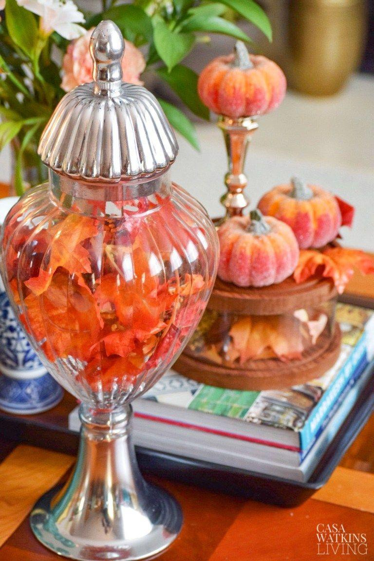 """<p>The latest apothecary jar trend: adapting them by the season. In this case, fill a glass jar with bold, colorful leaves in time for the autumn months. </p><p><a class=""""link rapid-noclick-resp"""" href=""""https://www.amazon.com/Diamond-Star-Apothecary-Decorative-Organizer/dp/B07ZQ5SDCT/?tag=syn-yahoo-20&ascsubtag=%5Bartid%7C10055.g.421%5Bsrc%7Cyahoo-us"""" rel=""""nofollow noopener"""" target=""""_blank"""" data-ylk=""""slk:SHOP JARS"""">SHOP JARS</a></p><p><em><a href=""""http://casawatkinsliving.com/2015/09/put-your-wallet-away-and-create-a-fall-vignette-with-items-in-your-home/"""" rel=""""nofollow noopener"""" target=""""_blank"""" data-ylk=""""slk:See more at Casa Watkins Living »"""" class=""""link rapid-noclick-resp"""">See more at Casa Watkins Living »</a></em> </p>"""