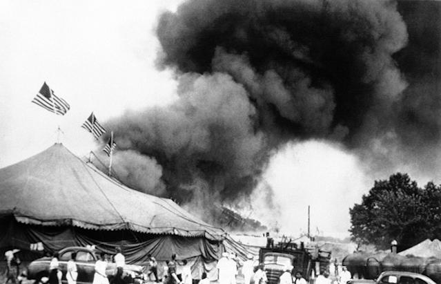 <p>Flames shoot from the top of the main tent of the Ringling Bros. and Barnum and Bailey Circus during performance at Hartford, Connecticut on July 6, 1944. Shortly after, the tent collapsed, trapping many of the patrons who were still in the arena. (AP Photo) </p>
