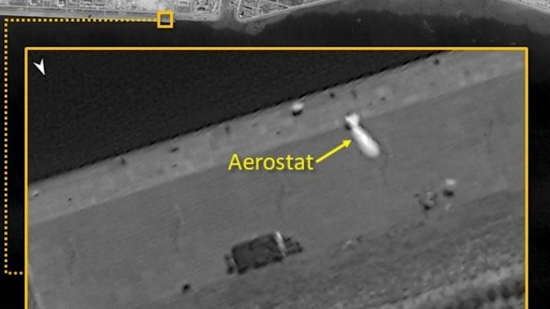 China deploys airship on outpost in disputed South China Sea, satellite firm says