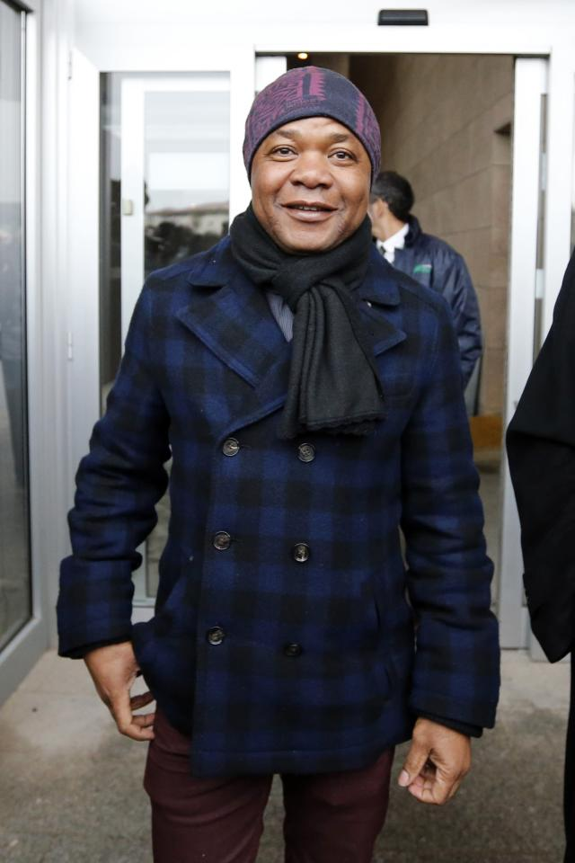 Patrick Lumumba, a Congolese bar owner whom Amanda Knox had accused of committing the murder of British student Meredith Kercher, leaves after attending a retrial session in Florence January 30, 2014. REUTERS/Giampiero Sposito (ITALY - Tags: CRIME LAW)