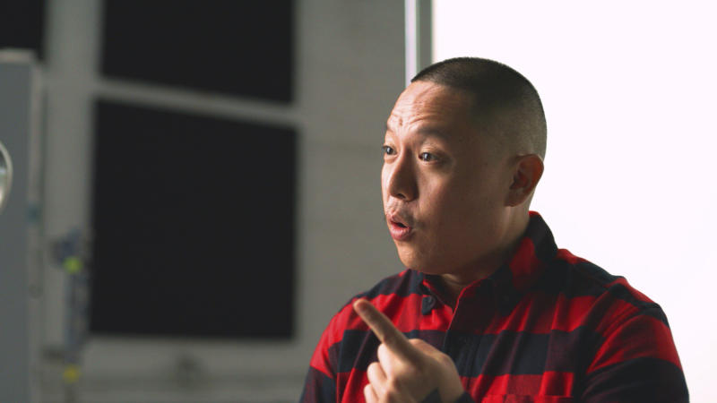 """In this Nov. 22, 2019, photo provided by Ajinomoto, chef Eddie Huang is seen in New York filming a video for a campaign challenging Merriam-Webster's dictionary entry of """"Chinese restaurant syndrome."""" Huang, a New York City-based chef and author (his memoir inspired the ABC sitcom """"Fresh Off the Boat""""), and TV's """"The Real"""" co-host Jeannie Mai are launching a social media effort Tuesday with Ajinomoto, the longtime Japanese producer of MSG seasonings. They plan to use the hashtag #RedefineCRS to challenge Merriam-Webster to rewrite the definition.  (Courtesy of Ajinomoto via AP)"""