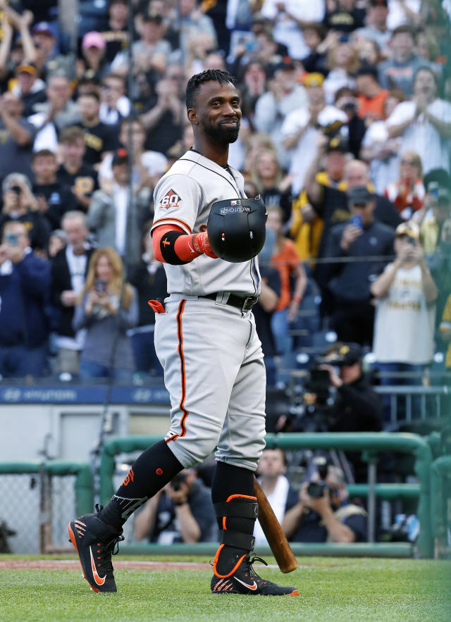 San Francisco Giants' Andrew McCutchen acknowledges fans during a tribute to his years with the Pittsburgh Pirates, before his first at-bat in the first inning of a baseball game in Pittsburgh, Friday, May 11, 2018. Pittsburgh Pirates starting pitcher Jameson Taillon struck out McCutchen. (AP Photo/Gene J. Puskar)