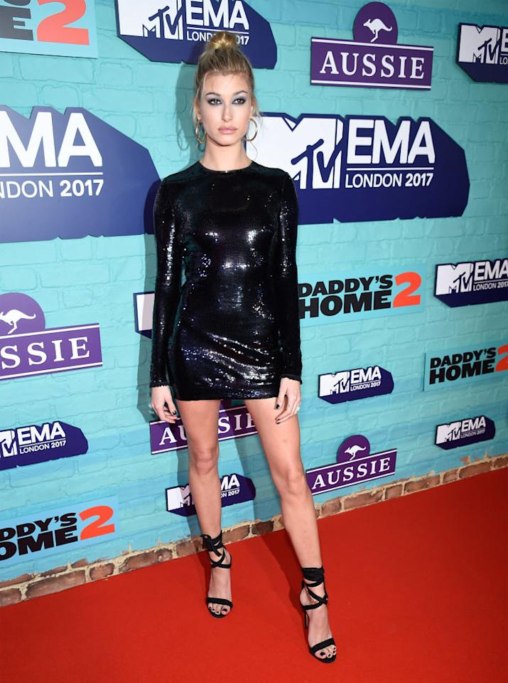 <p>Hailey Baldwin stole the spotlight in a sequinned mini dress by Tom Ford finished with Jennifer Fisher earrings. <em>[Photo: Getty]</em> </p>